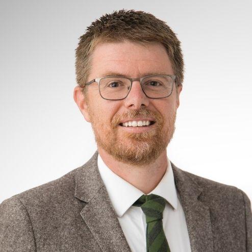 A headshot of Jim Watkins