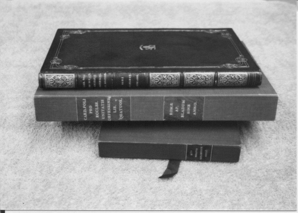 A stack of three reginald pole books.