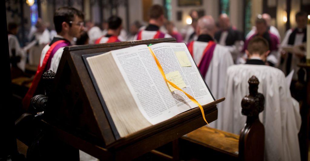 A close up of an open bible.