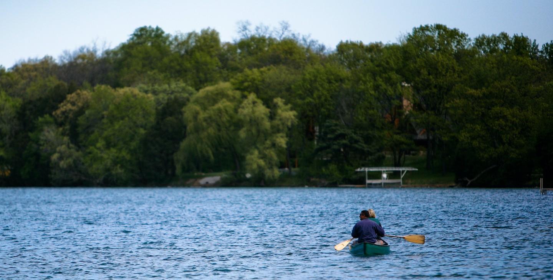 Two people kayaking on lake nashotah.