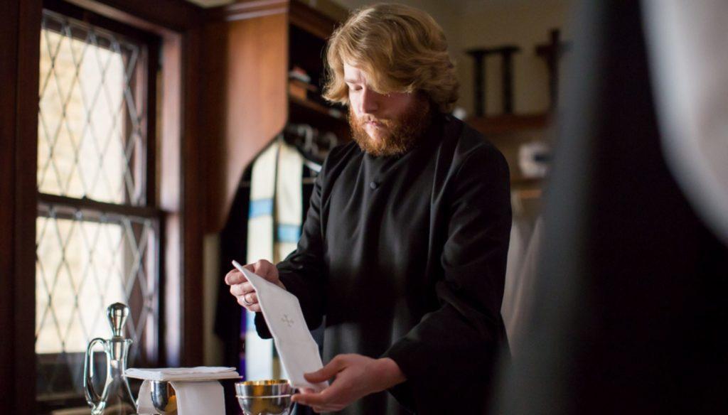 A person preparing for communion.